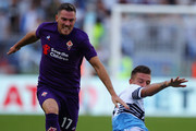 Sergej Milinkovic of SS Lazio competes for the ball with Jordan Veretout of ACF Fiorentina during the Serie A match between SS Lazio and ACF Fiorentina at Stadio Olimpico on October 7, 2018 in Rome, Italy.