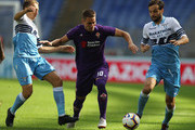 Lucas Leiva and Marco Parolo of SS Lazio compete for the ball with Marko Pjaca of ACF Fiorentina during the Serie A match between SS Lazio and ACF Fiorentina at Stadio Olimpico on October 7, 2018 in Rome, Italy.