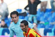 Jeda (R) of Lecce competes for the ball with Cristian Ledesma of SS Lazio during the Serie A match between SS Lazio and Lecce at Stadio Olimpico on January 9, 2011 in Rome, Italy.