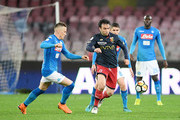 Piotr Zielinski of SSC Napoli vies with Giuseppe Rossi of Genoa CFC during the Serie A match between SSC Napoli v Genoa CFC at Stadio San Paolo on March 18, 2018 in Naples, Italy.
