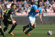 David Lopez (R) of Napoli competes for the ball with Leandro Greco of Verona during the Serie A match between SSC Napoli and Hellas Verona FC at Stadio San Paolo on April 10, 2016 in Naples, Italy.