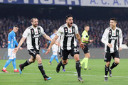Giorgio Chiellini, Emre Can and Cristiano Ronaldo celebrate the 0-2 goal scored by Emre Can during the Serie A match between SSC Napoli and Juventus at Stadio San Paolo on March 3, 2019 in Naples, Italy.
