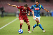 Simone Verdi of SSC Napoli vies James Milner of Liverpool during the Group C match of the UEFA Champions League between SSC Napoli and Liverpool at Stadio San Paolo on October 3, 2018 in Naples, Italy.