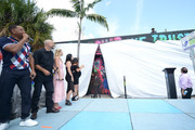 Actor Will Smith, director David Ayer, actress Margot Robbie, actress Karen Fukuhara, and artists Amanda Valdes, and Didirok onstage at the 'Suicide Squad' Wynwood Block Party and Mural Reveal on July 25, 2016 in Miami, Florida.