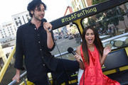 """Actor Hale Appleman and actress Summer Bishil of """"The Magicians"""" Surprise Fans and sing karaoke on the Karaoke Bus at San Diego Comic Con on July 21, 2017 in San Diego, California."""