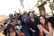 """Actor Hale Appleman and actress Summer Bishil of """"The Magicians"""" Surprise Fans on the Karaoke Bus at San Diego Comic Con on July 21, 2017 in San Diego, California."""