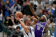 Devin Harris #34 of the Dallas Mavericks drives to the basket against Ty Lawson #10 of the Sacramento Kings in the first half at American Airlines Center on December 7, 2016 in Dallas, Texas. NOTE TO USER: User expressly acknowledges and agrees that, by downloading and or using this photograph, User is consenting to the terms and conditions of the Getty Images License Agreement.