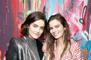 Models Daphne Velghe and Dasha Denisenko attend Saks Fifth Avenue And Good Luck Dry Cleaners Launch Underground Art-Themed Speakeasy, GLD@Saks at Level Zero - Saks Fifth Avenue on February 7, 2018 in New York City.