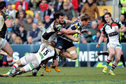 Andy Powell of Sale Sharks is hauled down by Ross Chisholm and George Lowe of Harlequins during the LV= Cup Final between Sale Sharks and Harlequins at Sixways Stadium on March 17, 2013 in Worcester, England.