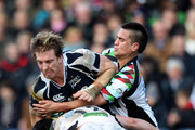 Andy Powell of Sale Sharks is tackled by Tom Casson and Ben Botica of Harlequins during the LV= Cup Final between Sale Sharks and Harlequins at Sixways Stadium on March 17, 2013 in Worcester, England.