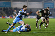 Johnnie Beattie of Montpellier beats a tackle from Aston Croall and Danny Cipriani of Sale Sharks on his way to scoring a try during the Heineken Cup Pool 6 match between Sale Sharks and Montpellier at Salford City Stadium on January 11, 2013 in Salford, England.