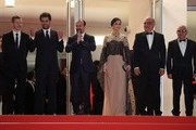 """(FromL) French producer and distributor Alexandre Mallet-Guy, Iranian actor Shahab Hosseini, Iranian director Asghar Farhadi, Iranian actress Taraneh Alidoosti, Iranian actor Babak Karimi and Iranian actor Farid Sajjadihosseini pose as they arrive on May 21, 2016 for the screening of the film """"The Salesman (Forushande)"""" at the 69th Cannes Film Festival in Cannes, southern France.  / AFP / Valery HACHE"""
