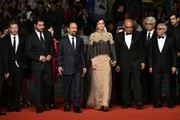 """(FromL) French producer and distributor Alexandre Mallet-Guy, Iranian director Asghar Farhadi, Iranian actress Taraneh Alidoosti, Iranian actor Babak Karimi and Iranian actor Farid Sajjadihosseini pose as they arrive on May 21, 2016 for the screening of the film """"The Salesman (Forushande)"""" at the 69th Cannes Film Festival in Cannes, southern France.  / AFP / ALBERTO PIZZOLI"""