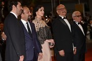 """(FromL) Iranian actor Shahab Hosseini, Iranian director Asghar Farhadi, Iranian actress Taraneh Alidoosti, Iranian actor Babak Karimi and Iranian actor Farid Sajjadihosseini pose as they arrive on May 21, 2016 for the screening of the film """"The Salesman (Forushande)"""" at the 69th Cannes Film Festival in Cannes, southern France.  / AFP / ALBERTO PIZZOLI"""