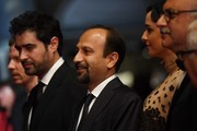 "Iranian director Asghar Farhadi (C) poses with French producer and distributor Alexandre Mallet-Guy, Iranian actor Shahab Hosseini, Iranian actress Taraneh Alidoosti, Iranian actor Babak Karimi and Iranian actor Farid Sajjadihosseini as they arrive on May 21, 2016 for the screening of the film ""The Salesman (Forushande)"" at the 69th Cannes Film Festival in Cannes, southern France.  / AFP / ANNE-CHRISTINE POUJOULAT"