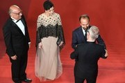 """Festival General Delegate Thierry Fremaux (R) welcomes (FromL) Iranian actor Babak Karimi, Iranian actress Taraneh Alidoosti and Iranian director Asghar Farhadi as they arrive on May 21, 2016 for the screening of the film """"The Salesman (Forushande)"""" at the 69th Cannes Film Festival in Cannes, southern France.  / AFP / François Xavier MARIT"""