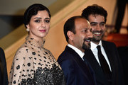 """(L-R) Actress Taraneh Alidoosti, director Asghar Farhadi and actor Shahab Hosseini attend """"The Salesman (Forushande)"""" Premiere during the 69th annual Cannes Film Festival at the Palais des Festivals on May 21, 2016 in Cannes, France."""
