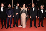 "Actor Farid Sajjadihosseini, film editor Babak Karimi, actress Taraneh Alidoosti, director Asghar Farhadi, actor Shahab Hosseini, and distributer Alexandre Mallet-Guy attend ""The Salesman (Forushande)"" Premiere during the 69th annual Cannes Film Festival at the Palais des Festivals on May 21, 2016 in Cannes, France."