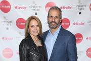"""Katie Couric and John Molner attend Sally Kohn Celebrates The Launch Of Her New Book """"The Opposite Of Hate"""" at Guggenheim Museum on April 6, 2018 in New York City."""