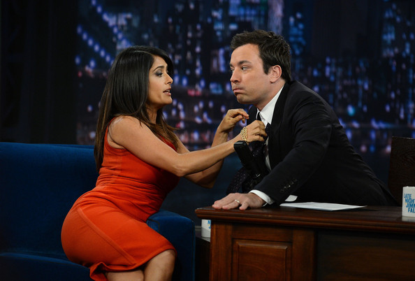 "Salma Hayek Actress Salma Hayek Pinault helps host Jimmy Fallon with his tie during a taping of ""Late Night With Jimmy Fallon"" at Rockefeller Center on October 12, 2012 in New York City."