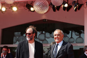 """Director Luca Guadagnino and Venice Film Festival director Alberto Barbera walk the red carpet ahead of the movie """"Salvatore - Shoemaker Of Dreams"""" And """"Fiori, Fiori, Fiori!"""" at the 77th Venice Film Festival on September 06, 2020 in Venice, Italy."""