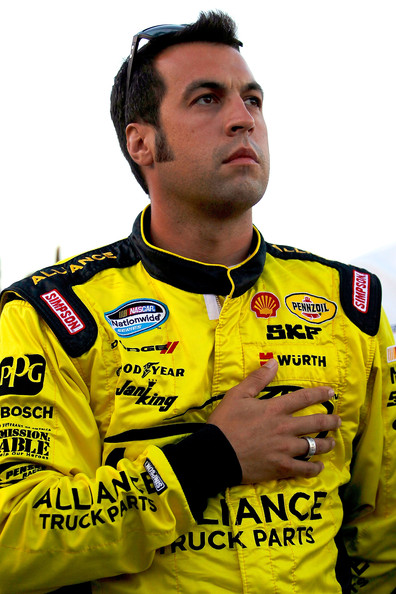 Sam Hornish Jr., driver of the #22 Shell/Pennzoil Dodge, stands on the grid after NASCAR announced that AJ Allmendinger failed a random drug test and was pulled from the #22 Shell Dodge prior to the NASCAR Sprint Cup Series Coke Zero 400 Powered by Coca-Cola at Daytona International Speedway on July 7, 2012 in Daytona Beach, Florida. Sam Hornish Jr. will be Allmendinger replacement for the Coke Zero 400. (July 6, 2012 - Source: Chris Graythen/Getty Images North America)
