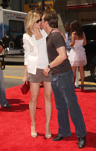 Sam and Leslie kissing passionately during the premier of animated move G-Force.