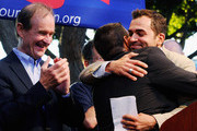 Plaintiffs Paul Katami (L) hugs his partner Jeff Zarrillo as their lawyer David Boies (R) looks on during a rally to celebrate the ruling to overturn Proposition 8 on August 4, 2010 in West Hollywood, California. A federal judge overturned California's Proposition 8, a same-sex marriage ban, finding it unconstitutional. The voter approved measure denies same-sex couples the right to marry in the State of California.
