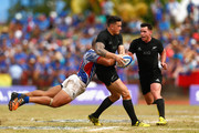 Sonny Bill Williams of the New Zealand All Blacks is tackled by Paul Perez of Manu Samoa  during the International Test match between Samoa and the New Zealand All Blacks at Apia Stadium on July 8, 2015 in Apia, Samoa.