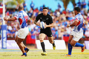 Sonny Bill Williams of the New Zealand All Blacks charges forward during the International Test match between Samoa and the New Zealand All Blacks at Apia Stadium on July 8, 2015 in Apia, Samoa.