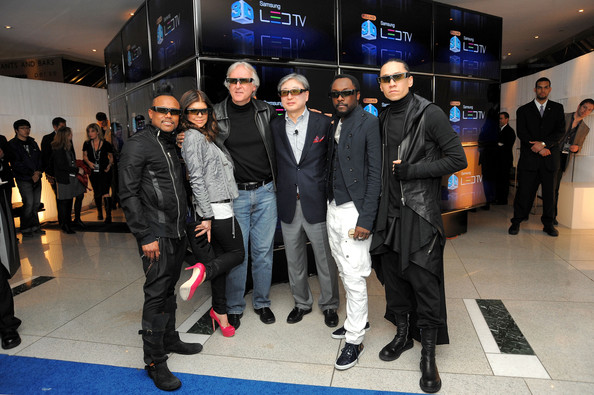 Director James Cameron and B.K. Yoon, President of Visual Display Business, Samsung Electronics (center) poses with Apl.de.Ap, Fergie, Taboo and Will.i.am of the Black Eyed Peas the Samsung 3D LED TV launch party with THE BLACK EYED PEAS at Time Warner Center on March 10, 2010 in New York City.