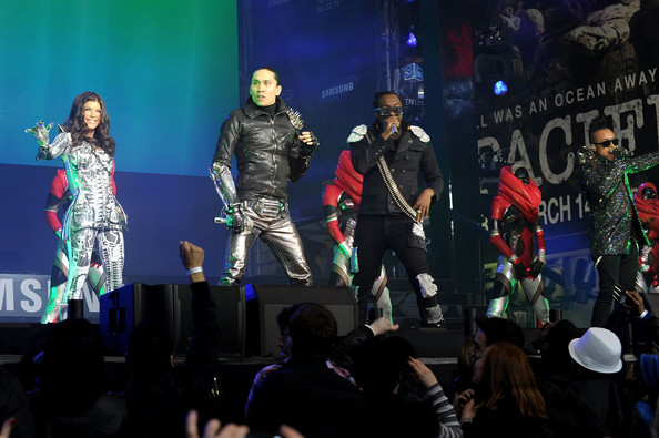 (L to R) Fergie, Taboo, Will.i.am, and Apl.de.Ap perform at the Samsung Times Square Concert with THE BLACK EYED PEAS at Times Square on March 10, 2010 in New York City.