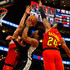 Kent Bazemore Photos - DeMar DeRozan #10 of the San Antonio Spurs drives against Alex Len #25 and Kent Bazemore #24 of the Atlanta Hawks in the second half at State Farm Arena on March 06, 2019 in Atlanta, Georgia.  NOTE TO USER: User expressly acknowledges and agrees that, by downloading and or using this photograph, User is consenting to the terms and conditions of the Getty Images License Agreement. - San Antonio Spurs v Atlanta Hawks