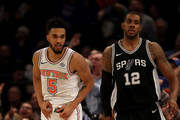 Courtney Lee #5 of the New York Knicks celebrates his three point shot as LaMarcus Aldridge #12 of the San Antonio Spurs looks on at Madison Square Garden on January 02, 2018 in New York City. NOTE TO USER: User expressly acknowledges and agrees that, by downloading and or using this photograph, User is consenting to the terms and conditions of the Getty Images License Agreement.
