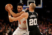 Courtney Lee #5 of the New York Knicks tries to get around Manu Ginobili #20 of the San Antonio Spurs in the first half at Madison Square Garden on January 02, 2018 in New York City. NOTE TO USER: User expressly acknowledges and agrees that, by downloading and or using this photograph, User is consenting to the terms and conditions of the Getty Images License Agreement.