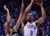 Russell Westbrook #0 of the Oklahoma City Thunder goes up for a shot over Tony Parker #9 of the San Antonio Spurs in the second quarter in Game Five of the Western Conference Finals of the 2012 NBA Playoffs at Chesapeake Energy Arena on May 31, 2012 in Oklahoma City, Oklahoma. NOTE TO USER: User expressly acknowledges and agrees that, by downloading and or using this photograph, User is consenting to the terms and conditions of the Getty Images License Agreement.