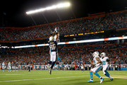 Brent Grimes #21 of the Miami Dolphins knocks down a hail mary at the end of the game against  Vincent Brown #86 of the San Diego Chargers during their game at Sun Life Stadium on November 17, 2013 in Miami Gardens, Florida.