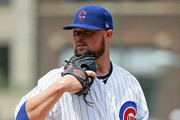 Starting pitcher Jon Lester #34 of the Chicago Cubs looks for the signs against the San Diego Padres at Wrigley Field on August 5, 2018 in Chicago, Illinois.