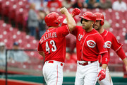 Joey Votto #19 of the Cincinnati Reds celebrates with Scott Schebler #43 of the Cincinnati Reds after hitting a grand slam against San Diego Padres in the second inning at Great American Ball Park on September 8, 2018 in Cincinnati, Ohio.