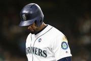 Nelson Cruz #23 of the Seattle Mariners wears a September 11th patch on his jersey as he walks back to the dugout after fouling out in the sixth inning against the San Diego Padres at Safeco Field on September 11, 2018 in Seattle, Washington.