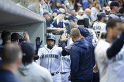 Nelson Cruz #23 of the Seattle Mariners is greeted in the dugout after hitting a home run, his 1,000th RBI, against the San Diego Padres in the fifth inning at Safeco Field on September 12, 2018 in Seattle, Washington.