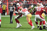 Defensive tackle DeForest Buckner #99 of the San Francisco 49ers hits quarterback Carson Palmer #3 of the Arizona Cardinals during the second half of the NFL game at the University of Phoenix Stadium on October 1, 2017 in Glendale, Arizona.