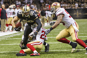 Jimmy Graham #80 of the New Orleans Saints is tackled at the five yard line by Carlos Rogers #22 of the San Francisco 49ers at  Mercedes-Benz Superdome on November 17, 2013 in New Orleans, Louisiana.  The Saints defeated the 49ers 23-20.