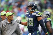 Tight end Jimmy Graham #88 of the Seattle Seahawks walks off the field with trainers after an apparent injury during the second quarter of the game at CenturyLink Field on September 17, 2017 in Seattle, Washington.