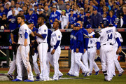 The Kansas City Royals bench comes to the field after words were exchanged between Salvador Perez #13 and Hunter Strickland #60 of the San Francisco Giants during Game Two of the 2014 World Series at Kauffman Stadium on October 22, 2014 in Kansas City, Missouri.