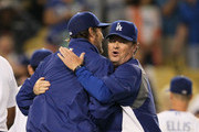 Pitching coach Rick Honeycutt #40 of the Los Angeles Dodgers hugs pitcher Clayton Kershaw #22 after they defeated the San Francisco Giants 4-2 in their MLB game at Dodger Stadium on June 26, 2013 in Los Angeles, California.