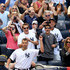 Andy Pettitte #46 of the New York Yankees salutes the fans during a curtain call after he was pulled from the game in the eighth inning against the San Francisco Giants during interleague  play on September 22, 2013 at Yankee Stadium in the Bronx borough of New York City.