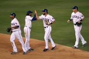 (L-R) Nelson Cruz #17, Elvis Andrus #1, Jeff Francoeur #21 and Josh Hamilton #32 of the Texas Rangers celebrate after their 4-2 win against the San Francisco Giants in Game Three of the 2010 MLB World Series at Rangers Ballpark in Arlington on October 30, 2010 in Arlington, Texas.