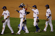 (L-R) Jeff Francoeur #21, Josh Hamilton #32, Bengie Molina #11, Julio Borbon #29, Ian Kinsler #5 and Elvis Andrus #1 of the Texas Rangers celebrate after the Rangers won 4-2 against the San Francisco Giants in Game Three of the 2010 MLB World Series at Rangers Ballpark in Arlington on October 30, 2010 in Arlington, Texas.