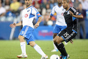 Marco Di Vaio #9 of the Montreal Impact passes the ball in front of Justin Morrow #15 of the San Jose Earthquakes during the match at the Saputo Stadium on August 18, 2012 in Montreal, Quebec, Canada.  The Impact defeated the Earthquakes 3-1.